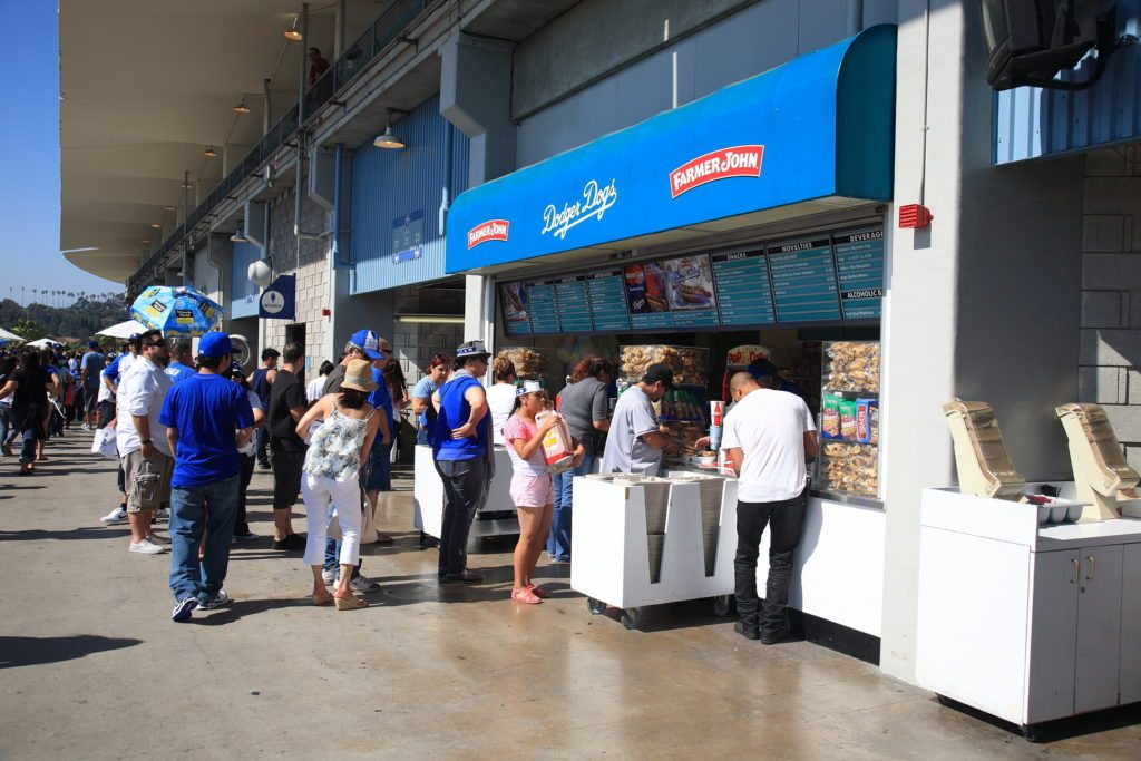 LOS ANGELES - JULY 1: Fans enjoy concessions at Dodger Stadium during a sunny day baseball game on July 1, 2012 in Los Angeles, California. Dodger Stadium opened in 1962 and cost $23 million.
