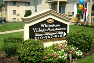 Whitestone Village Apartments sign apartment signage