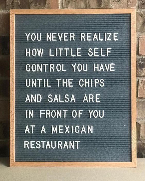 Sign about chips and salsa at Mexican food restaurants