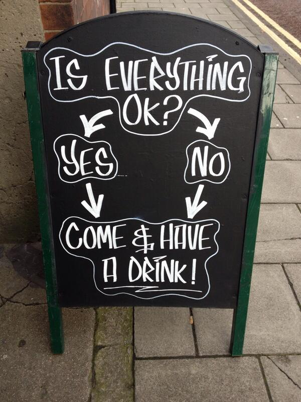 Outdoor bar sign telling customers to have a drink