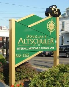 douglas altschuler free standing outdoor green sign
