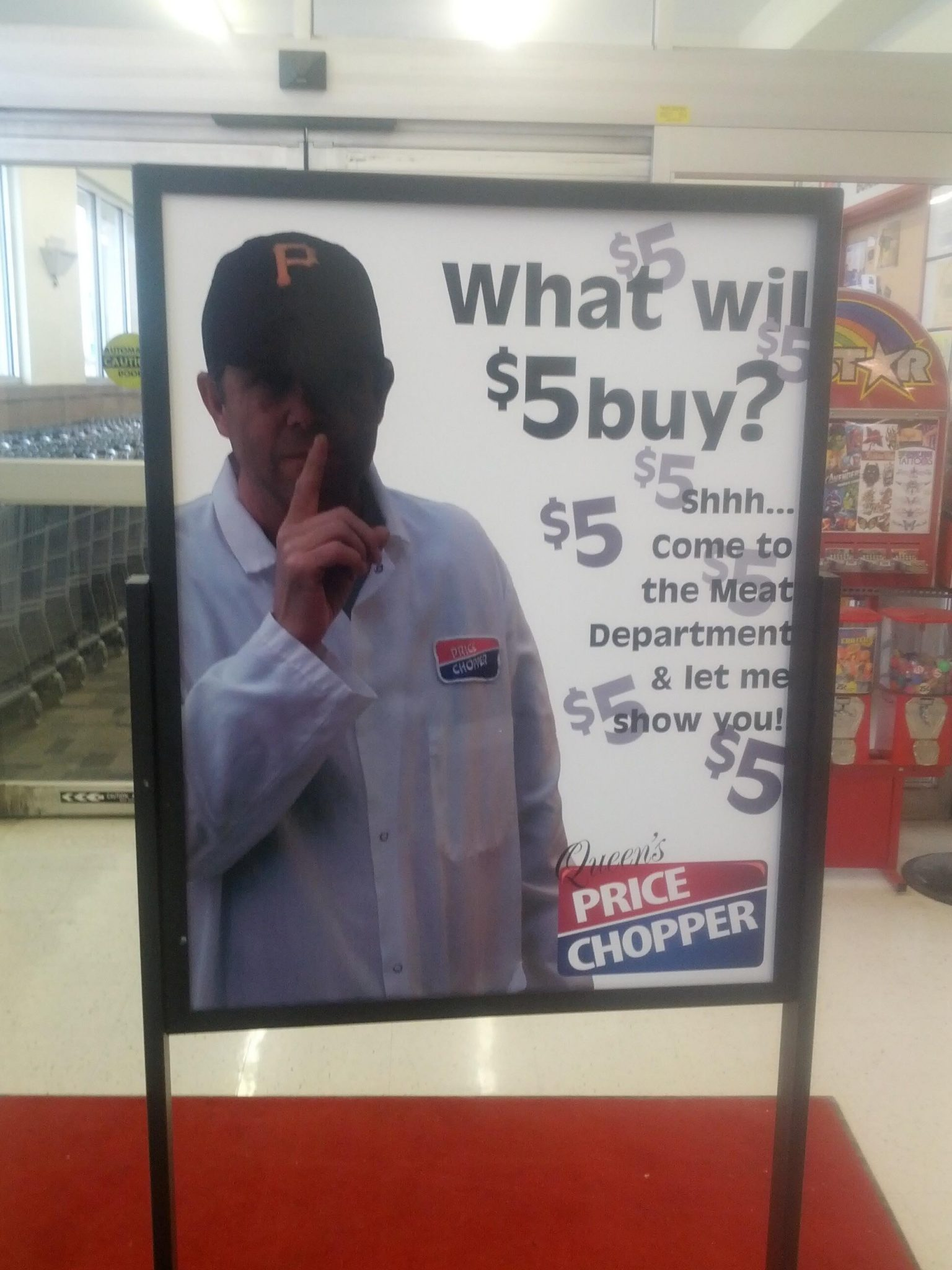 "Sign in grocery store with man whispering. it says, ""find out what $5 can buy"""